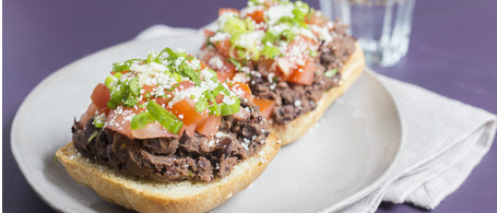 Molletes with Black Beans, Tomato & Cotija Cheese