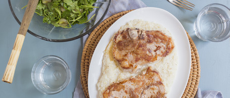 Berkshire Pork Chops & Grits with Arugula & Muscadine Salad