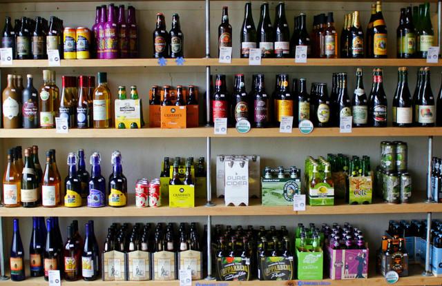 BeerGirl Shelf of multi-color craft beer bottles