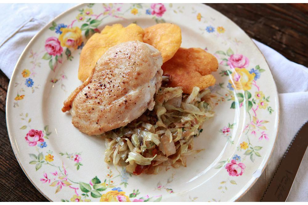 Chicken Breast with Fried Cabbage, Bacon & Hoecakes